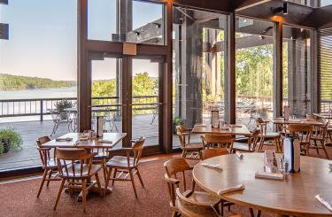 view from restaurant through large windows onto calm lake