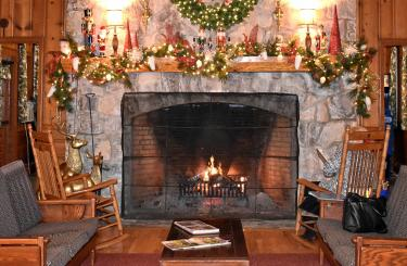 lodge fireplace decorated for the holidays
